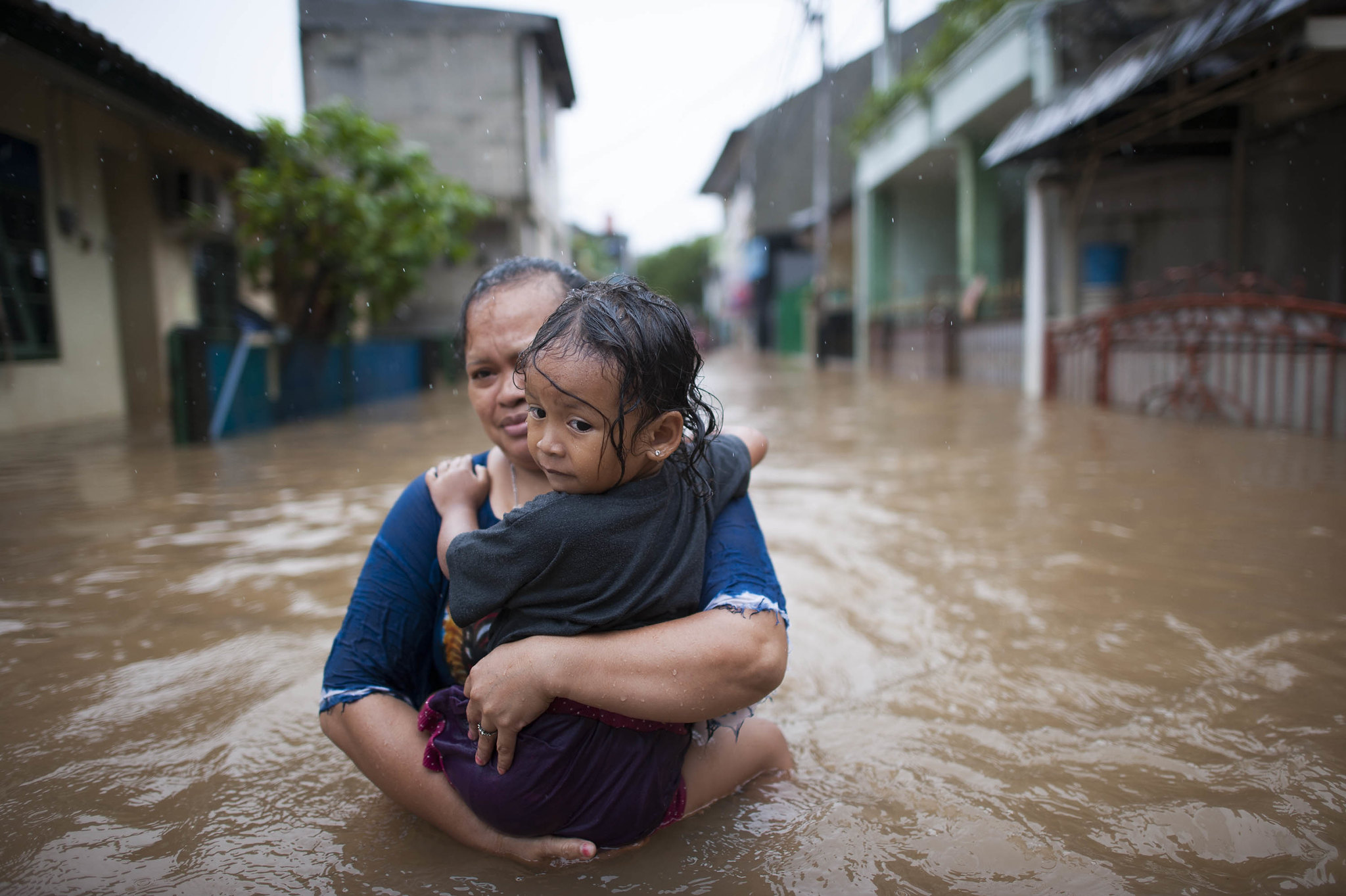 Woman and Child in Flood Water